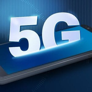 Cell phone on blue background with 5G rising out of the phone