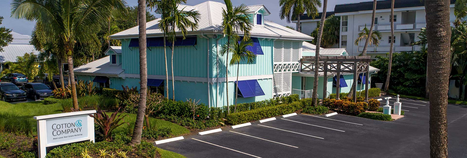 blue building in stuart florida cotton and company head quaters