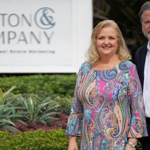 Laurie Andrews and Stephann Cotton in front of the Cotton & Company signage
