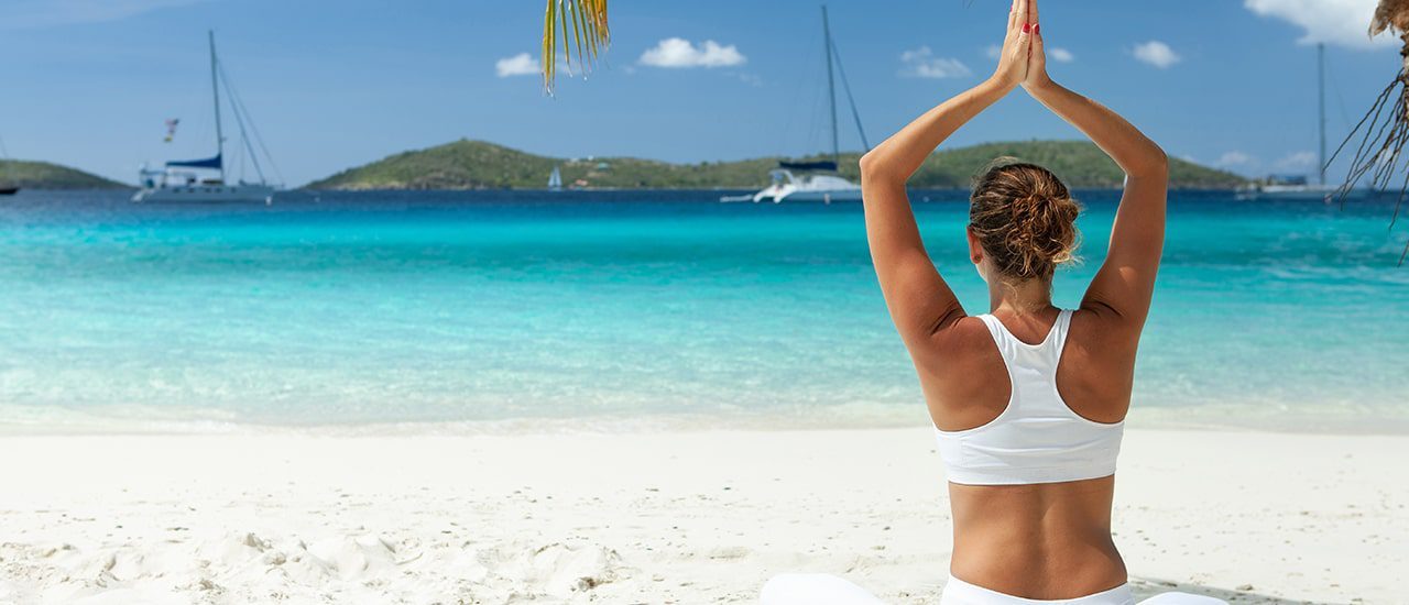 yoga in front of caribbean real estate